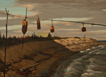 bouys hanging in front of shoreline with roof of house in distance
