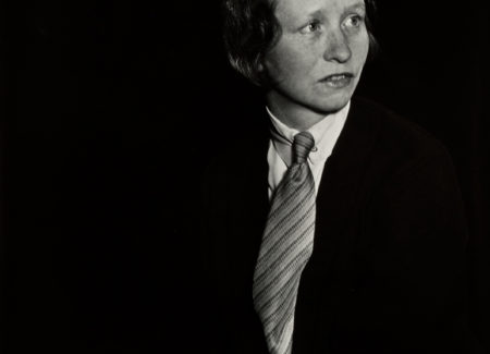 black-and-white image of woman wearing suit and tie