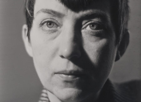 close up black and white photograph of woman with short dark hair
