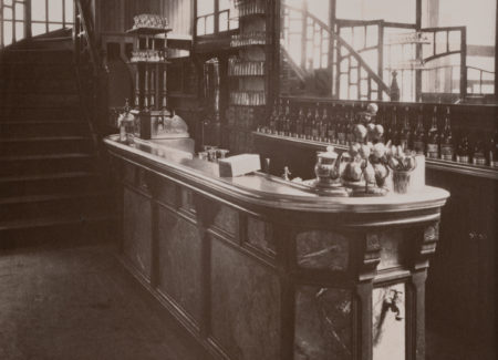 black and white photograph of bar counter