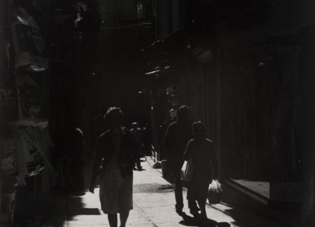 high contrast black and white photograph of people on street