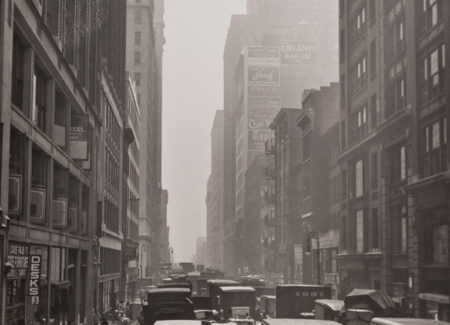 black and white photograph of busy city street