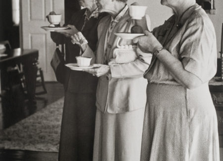 three older women holding tea cups and saucers, black and white photograph