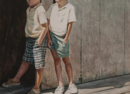 two young boys in shorts standing in doorway