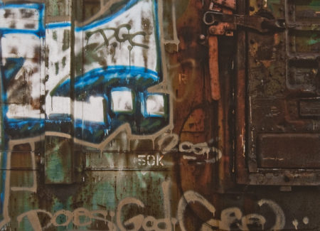 graffit wall with blue and brown paint, words