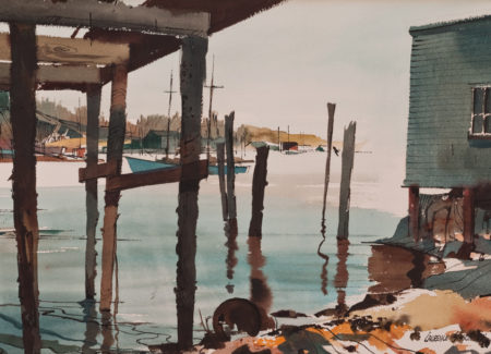 view from under pier of fishing boats in harbor, ocean-front building on stilts