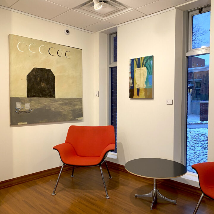 gallery wall showing two hung paintings