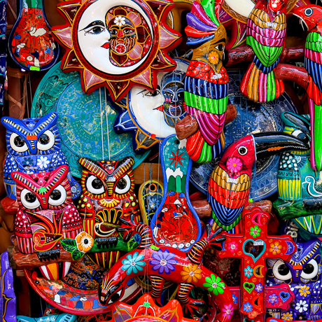 colorful mural featuring crescent moon, owls and fish