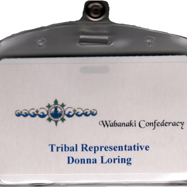 close up image of Donna Loring's Wabanaki Confederacy Tribal Representative name tag