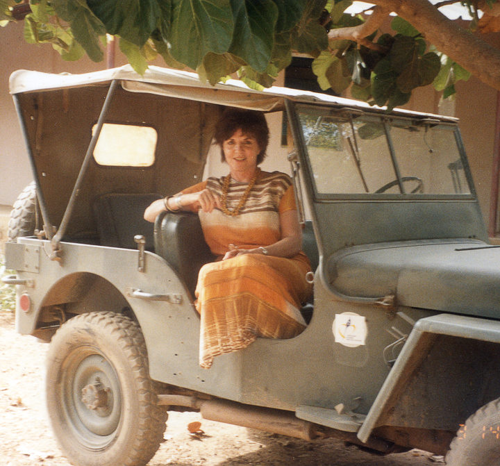 Huston sitting in a Jeep, Africa 1990s