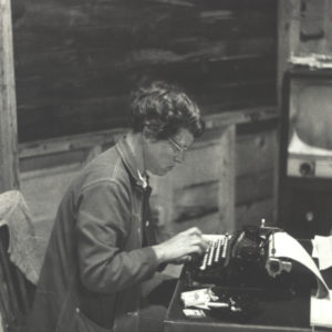 A. Carman Clark at her typewriter