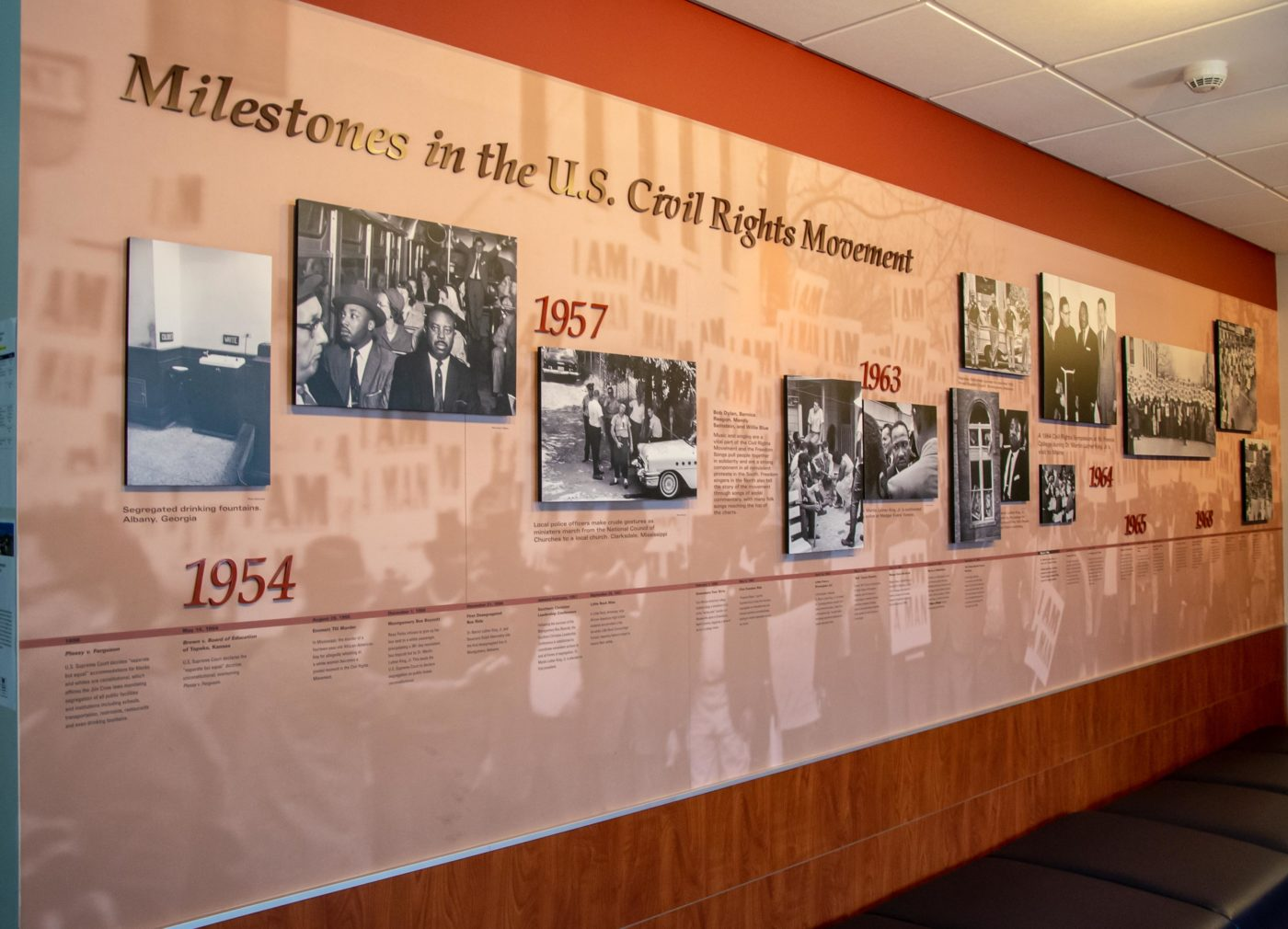 Milestones in the U.S. Civil Rights Movement exhibit wall with historical photographs and timeline