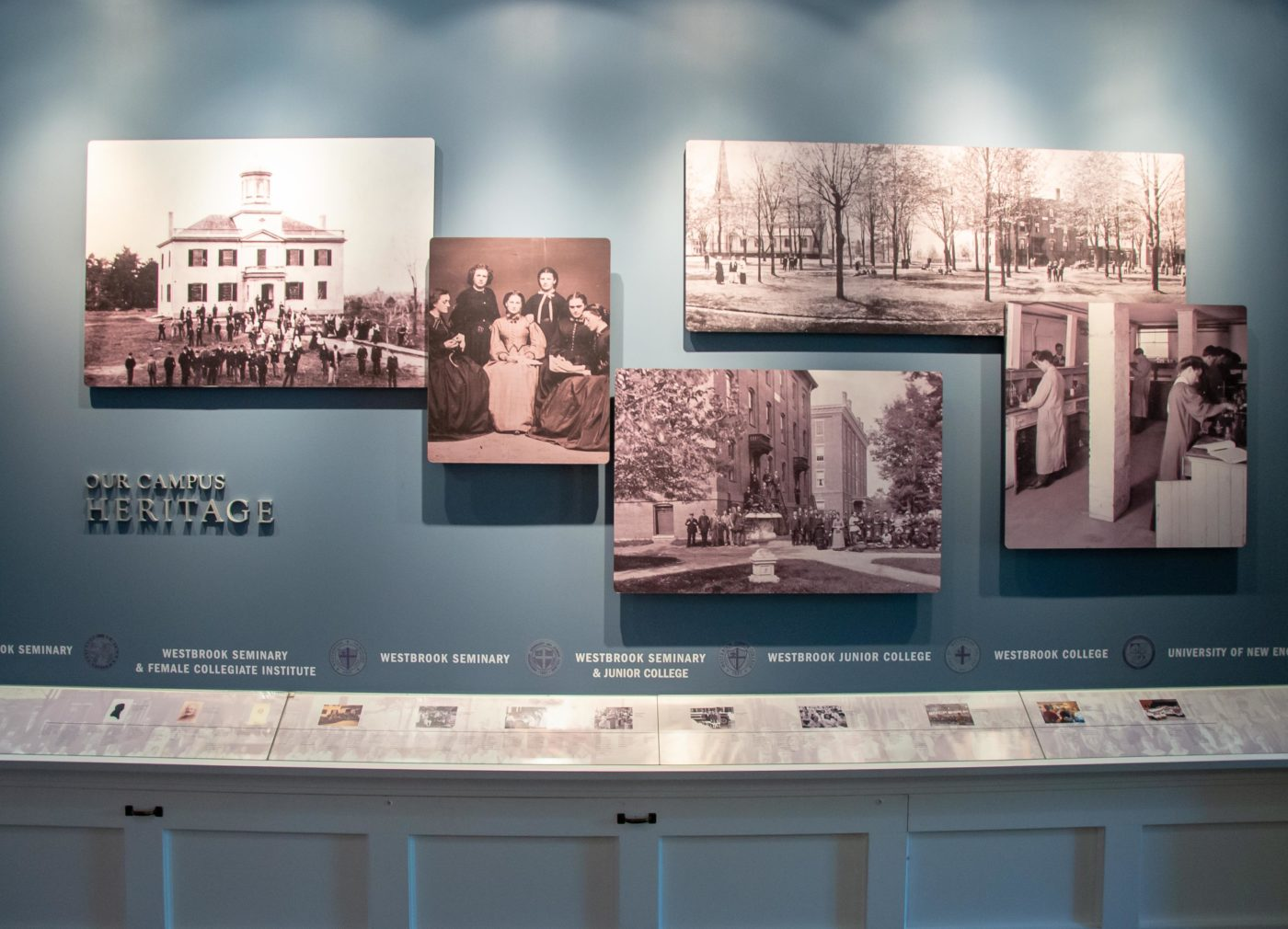 Our Campus Heritage exhibit wall with historical photos and timeline