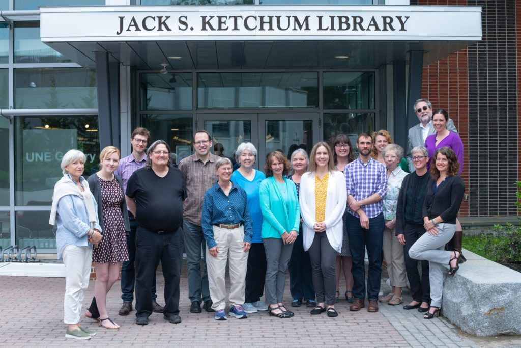 library staff gathered in front of the Ketchum Library front entrance.