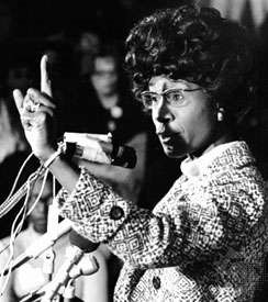 Image of Shirley Chisholm speaking into a microphone